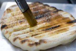 Brush Pizza Dough with Olive Oil