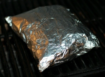 Grilling potatoes: the foil puffs up on the grill.