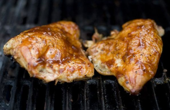 barbeque chicken on a gas grill