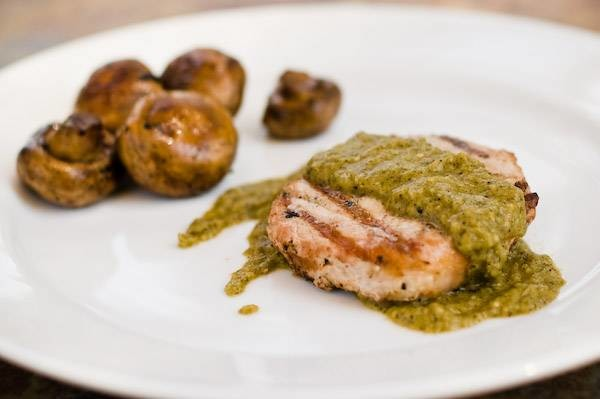 Man cannot live by pork chop alone.  Every now and then you must sauce it up a bit.  This smokey green sauce blends great with a pork chop.  The combination of roasted poblano peppers, tomatillos and garlic make a savory sauce.  This might also make a great base for a roasted corn and black bean salsa, which I might have to try some day soon.  I'll let you know when I do.  It's best to cook this recipe on a charcoal grill, so that the smokey flavor gets infused into the peppers and tomatillos and a side of mushrooms